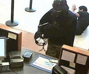 An unidentified man dressed as Darth Vader is seen robbing a Chase bank branch in Setauket