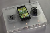 LG phone charging wirelessly on a glass surface