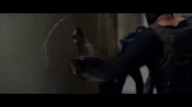 Bane punching through walls