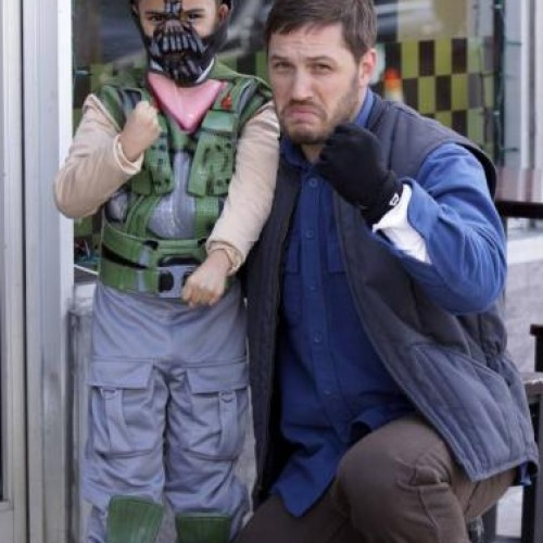 Tom Hardy poses with boy dressed as Bane