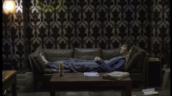 S1E3_Sherlock-stretched-on-his-sofa
