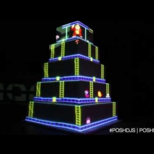 Nice use of a projector for this Mario and Donkey Kong-themed wedding cake