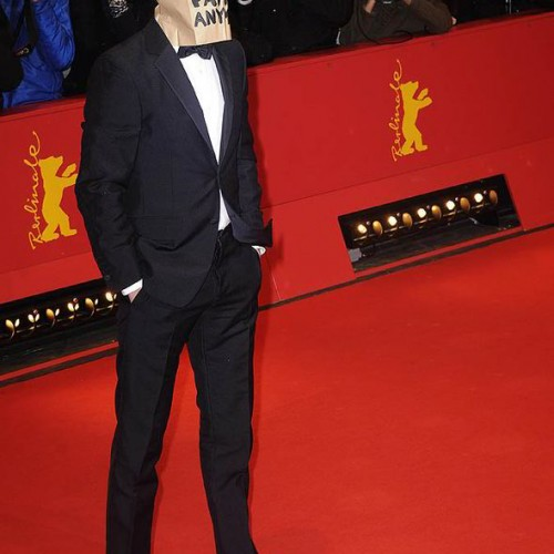 Shia LaBeouf covers his face with a bag at latest premiere