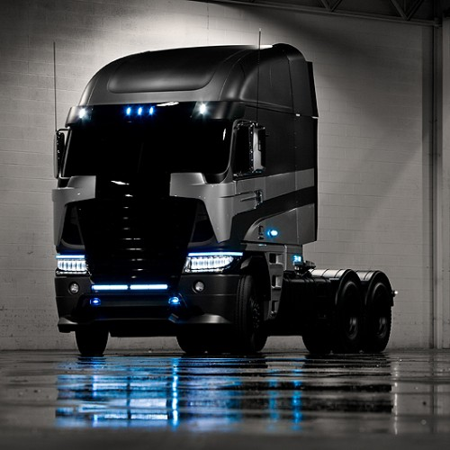 Optimus Prime's new model and another black semi-truck Transformer much like Optimus. Who could it be?