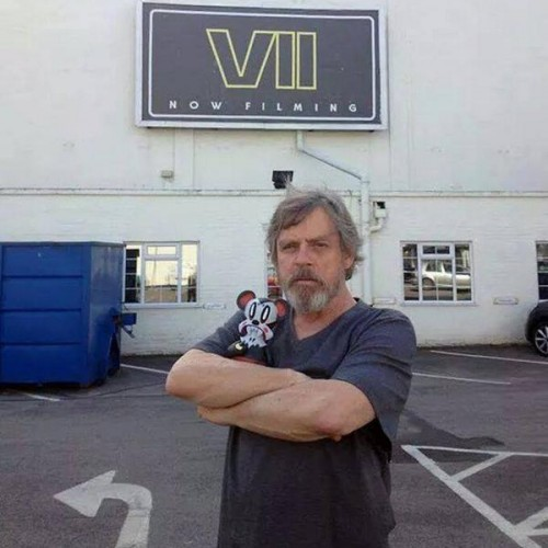 Mark Hamill poses with his jedi beard in front of Star Wars Episode VII set