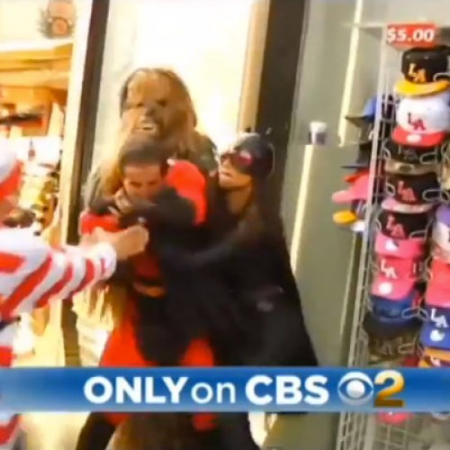 Chewbacca, Freddy Krueger and Waldo try to break up a fight between Batgirl and Mr. Incredible?