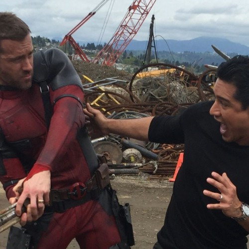 Ryan Reynolds talks Deadpool while in his suit with Mario Lopez