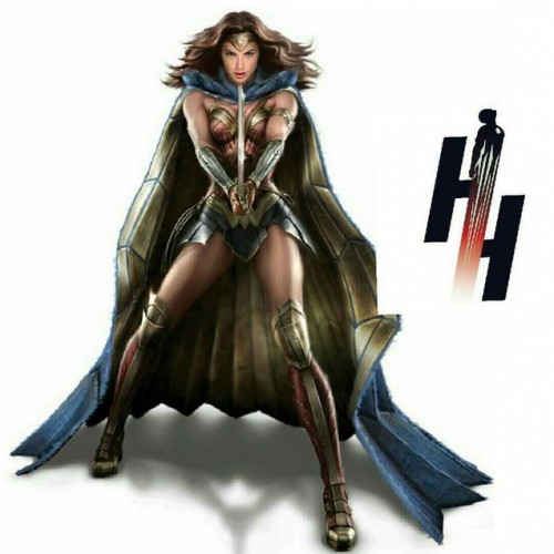 Wonder Woman wearing a big blue and gold cape in new Batman v Superman promo art