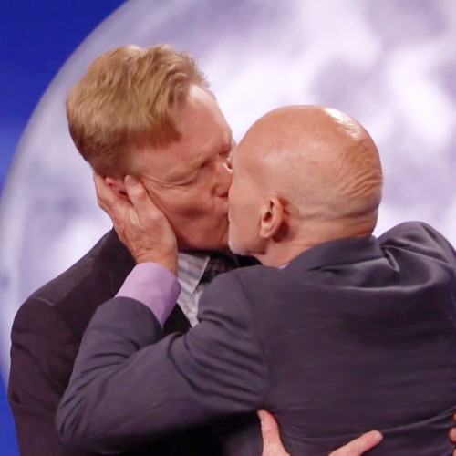 A Ship Is Born: Sir Patrick Stewart plants one on Conan O'brien