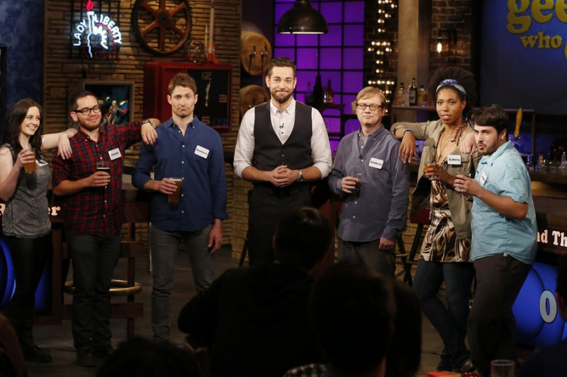 "GEEKS WHO DRINK -- ""Matthew McCaull VS. Andrew Daly"" Episode 101 -- Pictured: (l-r) Stacy Sholes, Jason Torres, Matthew McCaull, Zachary Levi, Andrew Daly, Aabria Lipscomb, Angel Castillo -- (Photo by: Carol Kaelson/Syfy)"