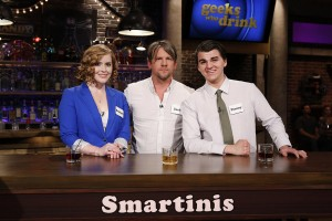 "GEEKS WHO DRINK -- ""Harold Perrineau VS. Zachary Knighton"" Episode 107 -- Pictured: (l-r) Bridget Bowes, Zachary Knighton, Timmy Heague-- (Photo by: Carol Kaelson/Syfy)"