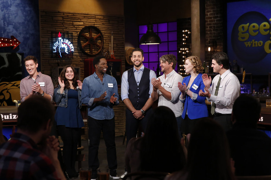 """GEEKS WHO DRINK -- """"Harold Perrineau VS. Zachary Knighton"""" Episode 107 -- Pictured: (l-r) Coburn Childs, Jessica Gonzalez, Harold Perrineau, Zachary Levi, Zachary Knighton, Bridget Bowes, Timmy Heague -- (Photo by: Carol Kaelson/Syfy)"""