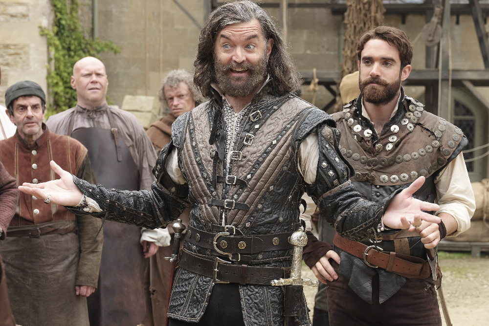 """GALAVANT - """"Aw, Hell, the King"""" - Desperate to raise an army and storm Hortensia, Galavant and King Richard return to his former castle to find the village thriving, now that they've found democracy. The discovery leads Richard to have an identity crisis now that his people don't need him. Galavant uses a town hall meeting to recruit fighters from the village, but the volunteers are in short supply. In Hortensia, an evil wedding planner named Wormwood poisons Isabella's mind with an enchanted tiara, intent on making her help him take over the kingdom. Meanwhile, Madalena threatens Sid with death unless he helps Gareth overcome his guilt-ridden nightmares about betraying Richard on """"Galavant,"""" airing SUNDAY, JANUARY 10 (8:00--8:30 p.m. EST) on the ABC Television Network. (ABC/Angus Young) TIMOTHY OMUNDSON, JOSHUA SASSE"""
