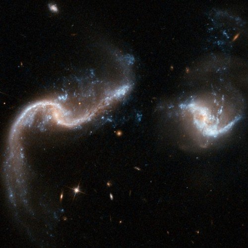 Two galaxies are slowly merging together