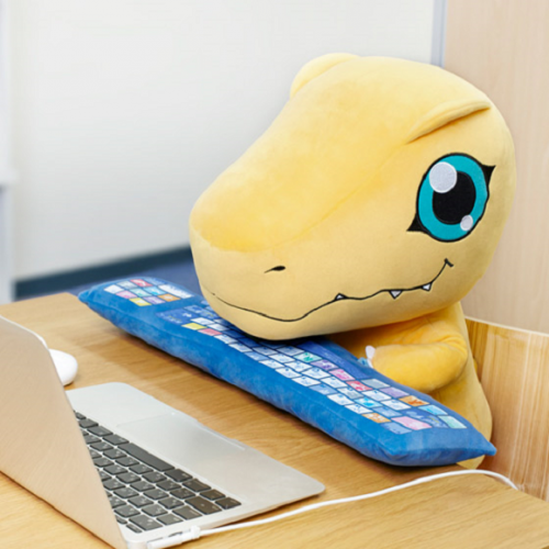 Digimon's Agumon keyboard wrist support and plush