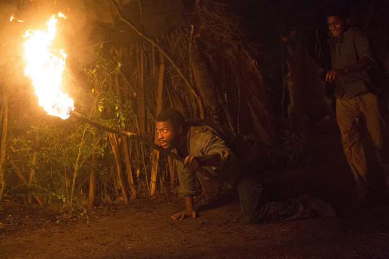 Noah-Aldis-Hodge-Carrying-a-Torch-About-to-Spring-Into-Action