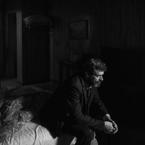 Hugh Jackman as Logan contemplates in new black and white photo