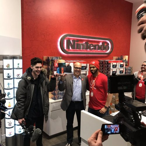 Doug Bowser hands CND first Switch at Nintendo NY