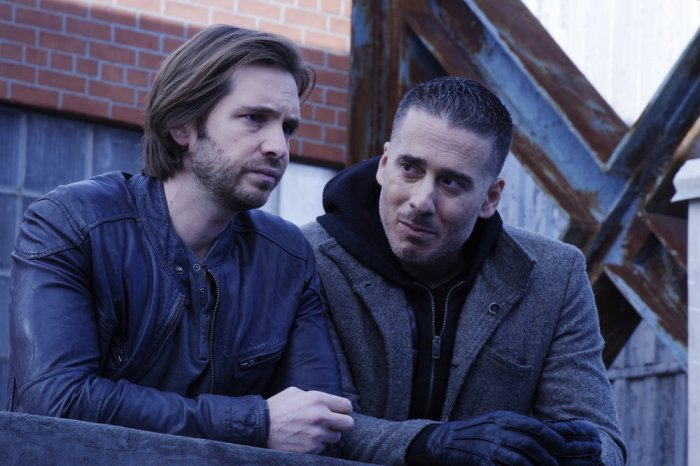 "12 MONKEYS -- ""Enemy"" Episode 303 -- Pictured: (l-r) Aaron Stanford as James Cole, Kirk Acevedo as Jose Ramse -- (Photo by: Ben Mark Holzberg/Syfy)"